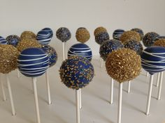 Blue and gold cake pops