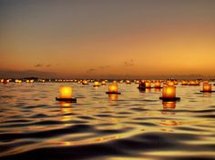 Honolulu, Hawaii    Memorial Day ceremony at Ala Moana Beach Park in which people release lanterns onto the Pacific to honor the dead