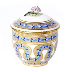 A Sèvres sugar bowl, the porcelain 18th century, decoration later Painted in blue with stylised husks on gilded bands reserved on a white ground, within gilded dentil borders, the cover with a flower finial