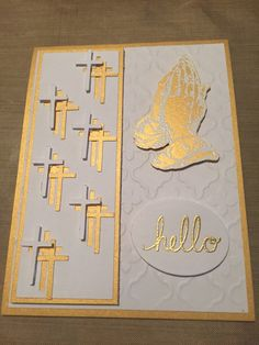 White and gold dimensional note with die-cut Crosses cut with the Silhouette Cameo,  tri-color Crosses and gold praying hands on a textured background and a hold 'hello'.