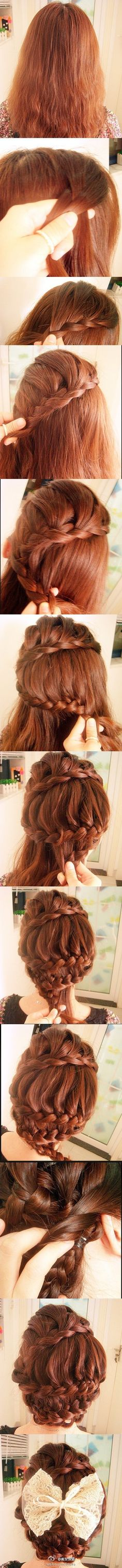amazing hair braid/bun! minus the big bow , this is really a cute style. I would probably fit one more horizontal braid in before bringing it together at the bottom to fill in the gap. Pretty !