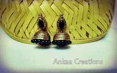 handmade terracotta jhumka ...in gold and black combo....plz visit https://www.facebook.com/ankaa.creations and give us a like..thank you :)