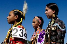 Crow Fair is now considered the largest modern day American Indian encampment in the United States. Crow Indians, Jingle Dress, Pow Wow, Woman Face, American Indians, Faces, Dresses, Fashion, Native Americans