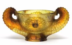 A G. Argy-Rousseau dish with wing handles, designed in 1927, pate-de-verre in yellow, honey-colour, red-brown and black, signature G. Argy-Rousseau, height 10.5 cm, length 20.5 cm