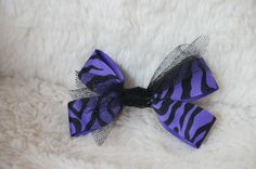 Purple and Black Animal Print Grosgrain Blow with Black Tulle center via Etsy