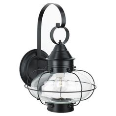 One-light outdoor wall lantern in black. Crafted of brass with an oval clear glass shade.Product: Wall lanternConstruction...