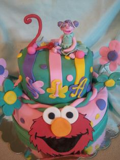 Made by LaKeisha Keck with Sweet Tooth Mother and Daughter cakes.  Elmo little girl cake.