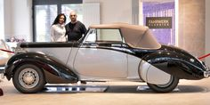 p Car saler Sabri Carkan and his wife Saliha stand behind a Daimler DB 18 Drophead Coupe in their showroom in Enger, Germany, Monday, April 29, 2013. Experts believe the vintage Daimler DB 18 Drophead Coupe is the only one of its kind left. Only eight of these cars were produced since 1939. The rare car was used by Britain's wartime leader Winston Churchill between 1944 and 1949 is being sold on auction site eBay. (AP Photo/Martin Meissner)