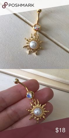 Golden Pearl Sun Belly Button Ring Condition: Brand New Metal : Gold Plated Surgical Steel Size: 14 Gauge If you have any questions please leave a comment down below. Reasonable offers will be accepted I do not trade . -Belly Button Ring Navel Piercing 14G Surgical Steel Body Jewelry New- Jewelry Rings