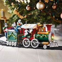 """All aboard! Join your favorite Disney pals on the track to Christmas with this adorable train set. Includes a 53"""" diam. track with Mickey Mouse, Donald Duck, Goofy and Pluto on board. Regularly $79.99, shop Avon Home products online at http://eseagren.avonrepresentative.com"""