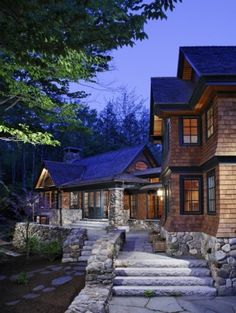 Love all the stone and the siding!! So like the woodlands!! beautiful home