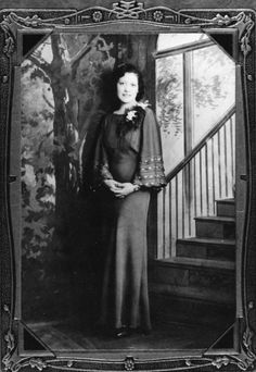 Nellie Castro Tafoya stands for a portrait, ca. 1937.
