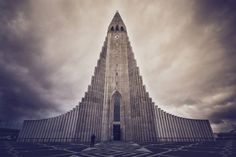 This bucket-list series is great to read through as you plan your trip to Iceland. So here it is, 5 must-see things in Reykjavik that should be on your list Architectural Prints, Urban Photography, Photography Tutorials, Photography Tips, Modern Buildings, Modern Skyscrapers, Kirchen, Stock Photos, Reykjavik Iceland