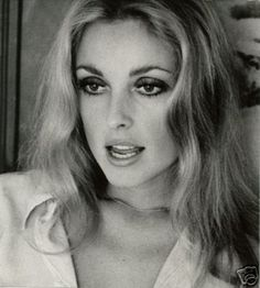 Sharon Tate. Gorge.a little like jennifer esposito? (too late for jenn to play her tho....)