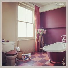 Don't be afraid to play with color in your bathroom, like this aubergine and salmon example.
