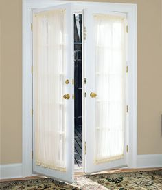 Country Curtains Sheer Door Panel @ Country Curtains and they have matching tiebacks to use as the standard hourglass shape.  Entry