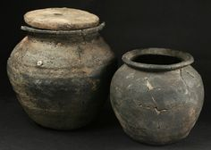 Cooking pots from Coppergate, York, one with wooden lid, Viking era.