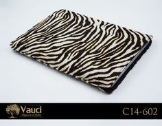 Our Zebra Hair on Hide custom leather laptop sleeve, is incredibly durable and fits all standard sizes. Fits snug and looks great! Reserve yours now at 561-705-0611.