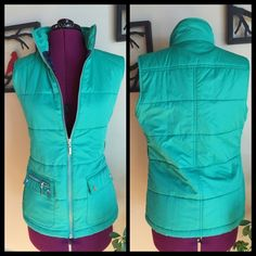 Green puffy vest Liven up your outfits with this bright and practical vest! Who says comfort can't be fashionable? Complete with multiple pockets, shiny silver zippers and belt loops if you'd like to belt it. Size S Merona Jackets & Coats Vests