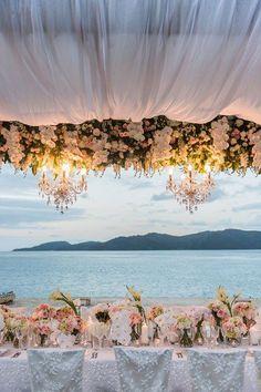Romantic blush floral beach wedding reception; Featured Photographer: Studio Impressions