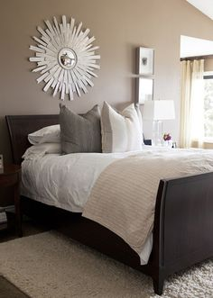 bedrooms - Arteriors Galaxy Star Mirror mocha walls espresso stained wood sleigh bed ivory wool rug gray silk pillows pink quilt sloped ceiling