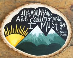 The Mountains are calling and I must go wood slice
