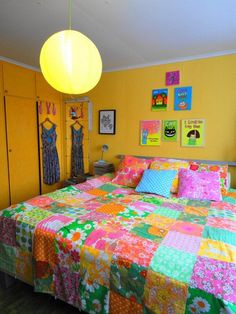Patchwork bed cover & yellow wardrobes