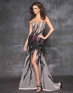Blush Prom 9507 - Beaded elegance in a formal prom dress! Sexy crystals in black, red and violet create a flame-motif that flows assymetrically.  #prom