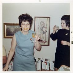 Party's started: Inez is using a drink garnish in a slightly amusing way.