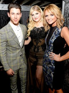 Unlikely TrioPresenters Nick Jonas and Meghan Trainor grabbed Grammy winner Miranda Lambert for a backstage snap. Is Nick jealous that Meghan's all about Miranda's little red wagon?