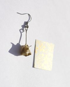 https://www.etsy.com/listing/218385135/tiny-white-and-gold-tulip-origami?ref=shop_home_active_6