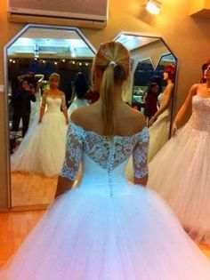 Beautiful White Wedding Dress with Lace Sleeves.