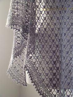 Un super châle ou une super écharpe faite par maman en super laine trop classe.