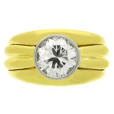 BOUCHERON Solitaire Diamond Gold Ring | From a unique collection of vintage solitaire rings at https://www.1stdibs.com/jewelry/rings/solitaire-rings/