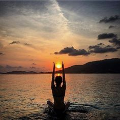 Ahhh! That looks relaxing.  Beautiful yoga pose while the sun goes down.  What a calm and serine way to end the day.  #YogaInspiration