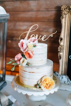 elegant wedding cake - photo by Lora Grady Photography http://ruffledblog.com/fairytale-cottage-wedding-at-craven-farm