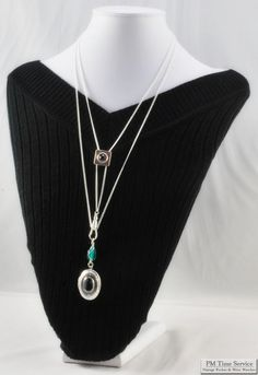 Slide chain necklace, attractive fully engraved locket with a lustrous natural black Hemalyke cabochon.  $55, on Etsy.