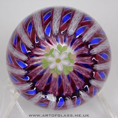 Beautiful white blue red lattice ribbon paperweight with suspended flower design encased Made by Perthshire Paperweights Scotland Has the P 1996 date