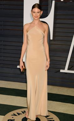 Behati Prinsloo attended the 2015 Vanity Fair Oscar Party, in Calvin Klein gown and earrings and a bracelet by Norman Silverman Diamonds.