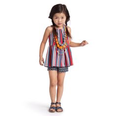 Tea Collection - For an eye-catching combination, pair this Venda Stripe Twirl top with any of our playshorts. Note the beautiful bow on the back. Family Photo Outfits, Girl Outfits, Summer Outfits, Girls Tees, Shirts For Girls, Little Girl Fashion, Kids Fashion, Kids Studio, Little Doll