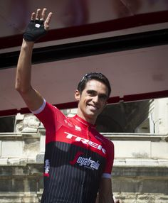 "Trek-Segafredo Spanish cyclist Alberto Contador waves prior to the start of the 2nd stage of the 72nd edition of ""La Vuelta"" Tour of Spain cycling race, a 203,4km route between Nimes to Gruissan on August 20, 2017. / AFP PHOTO / JAIME REINA"