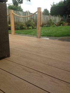Millboard composite decking with oak posts and rope balustrade. Rope Fence, Rope Railing, Diy Fence, Deck Railings, Deck Posts, Garden Posts, Garden Ideas, Wpc Decking, Composite Decking