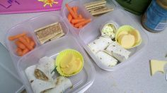 Right; egg salad sandwich wrap left; peanut butter and honey wrap on both pumpkin cheese slices, grahm crackers and carrots.