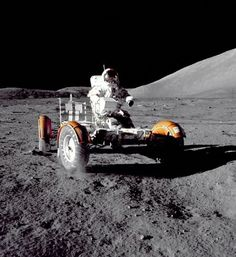 Astronaut Eugene A. Cernan of the 1972 Apollo 17 mission takes the lunar roving vehicle for a spin.
