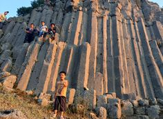 Kids on the basalt columns, Cakirca Village, Kula Geopark, Turkey