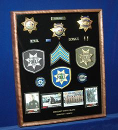 The customer sent his items to ShadowBoxUSA.com and they custom built this shadow box from walnut wood and mounted all the items securely. The final product captures a 30-year law enforcement career very well.