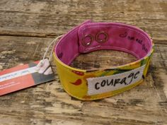 "Handcrafted by Amy Frank of Mindfully Made Studios, this COURAGE Blessing band is made to fit any adult wrist. This bracelet is made of double-interfaced patchwork cotton and features two adjustable pearlized snap closures. The cuff is 7-8"" x 1"".  Spot-cleaning or dry-cleaning recommended."