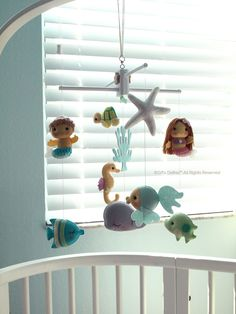 Title: Two Mermaids with Sea Friends Theme: Mermaid, Under the Sea, Nautical Featuring charming mermaid boy and mermaid girl accompanied with under the sea friends: turtle, goldfish, starfish, butterfly fish, clown fish, corals and the friendly whale for centerpiece! Whimsical decorative piece for kids' playroom or baby nursery with Under the Sea theme, mermaids, nautical, aquatic, ocean, sea world, beach, aquarium.