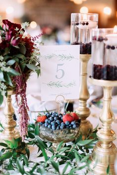 Fall wedding centerpiece decor and table numbers. Love the berry theme with blueberry, saskatoon berry, strawberries and raspberries and the deep hues of gold, navy and burgundy. Perfect rich hues for a fall wedding in the mountains. Chateau Lake Louise Wedding, table setting, flowers, calgary photographers nicole sarah