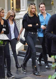 Street chic: Gigi Hadid showed off her impeccable style while hitting the shops with a gaggle of friends in Soho, New York City on Saturday
